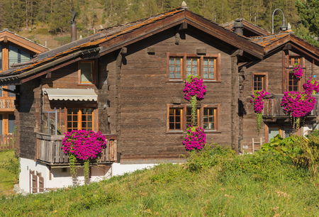 Zermatt, Switzerland - September 15, 2018: wooden houses in the town of Zermatt. Zermatt is a municipality in the district of Visp in the Swiss canton of Wallis, it is a famous mountaineering and ski resort. Editorial