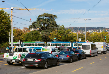 Zurich, Switzerland - September 29,  2017: traffic on General Guisan quay in the city of Zurich. General Guisan quay is named after Henri Guisan, who was the commander in chief of the Swiss Armed Forces during the Second World War. Editorial