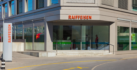 Chur, Switzerland - September 27, 2018: an office of the Raiffeisen bank in the city of Chur, people inside it. Raiffeisen is a Swiss cooperative bank and the third largest bank in Switzerland after the UBS and Credit Suisse.