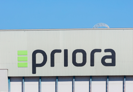Kloten, Switzerland - September 30, 2016: a building at Zurich Airport bearing the sign of the Priora AG company. The Priora AG provides real estate construction, development, general contracting, and facility management services.