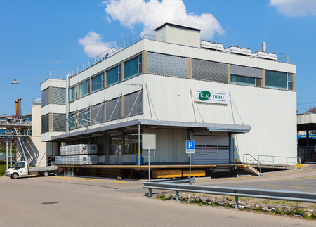 Hedingen, Switzerland - April 19, 2019: one of the buildings of the KLK Kolb company. The KLK Kolb manufactures surfactants, paper process chemicals and other chemical specialties, it is a part of the KLK OLEO group of companies. The site in Hedingen was