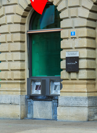 Zurich, Switzerland - August 1, 2016: ATM of the Credit Suisse bank on Paradeplatz square in the city of Zurich. The Credit Suisse Group AG is a Swiss multinational investment bank and financial services company headquartered in Zurich. Sajtókép