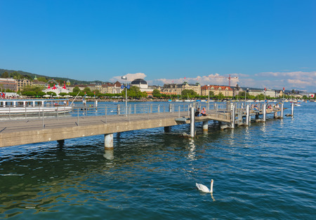 Zurich, Switzerland - May 11, 2018: Lake Zurich, buildings of the city of Zurich, people on a pier. Lake Zurich is a lake in Switzerland, extending southeast of the city of Zurich, which is the largest city in the country and the capital of the Swiss cant Sajtókép