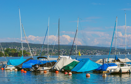 Zurich, Switzerland - May 11, 2018: boats at a pier on Lake Zurich, view from the city of Zurich. Lake Zurich is a lake in Switzerland, extending southeast of the city of Zurich, which is the largest city in the country and the capital of the Swiss canton Sajtókép