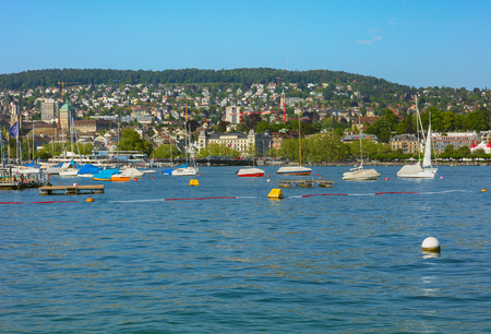 Zurich, Switzerland - May 11, 2018: Lake Zurich, buildings of the city of Zurich in the background. Lake Zurich is a lake in Switzerland, extending southeast of the city of Zurich, which is the largest city in the country and the capital of the Swiss cant