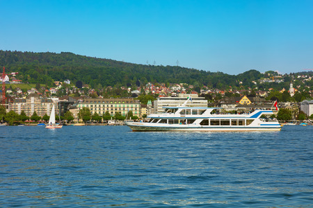 Zurich, Switzerland - May 11, 2018: boats on Lake Zurich, buildings of the city of Zurich in the background. Lake Zurich is a lake in Switzerland, extending southeast of the city of Zurich, which is the largest city in the country and the capital of the S Sajtókép