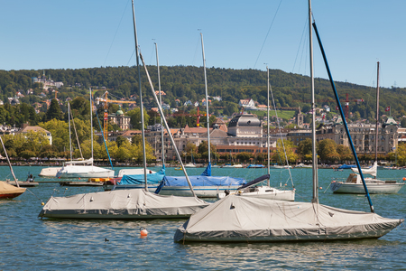 Zurich, Switzerland - August 26, 2010: boats on Lake Zurich, buildings of the city of Zurich in the background. Lake Zurich is a lake in Switzerland, extending southeast of the city of Zurich, which is the largest city in the country and the capital of th Sajtókép
