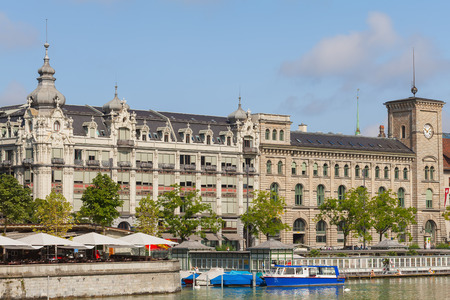 Zurich, Switzerland - August 4, 2014: buildings of the historic part of the city of Zurich along the Limmat river, people on the platform of the Frauenbad public bath. Zurich is the largest city in Switzerland and the capital of the Swiss canton of Zurich Sajtókép
