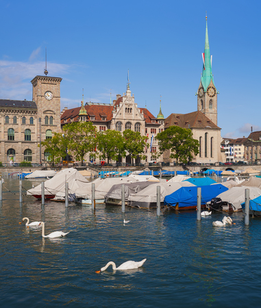 Zurich, Switzerland - August 4, 2014: the Limmat river and buildings of the historic part of the city of Zurich along it. Zurich is the largest city in Switzerland and the capital of the Swiss canton of Zurich.