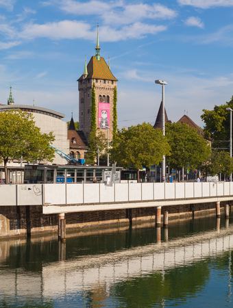 Zurich, Switzerland - August 14, 2011: embankment of the Limmat river, tower of the Swiss National Museum. Zurich is the largest city in Switzerland and the capital of the Swiss canton of Zurich. Sajtókép