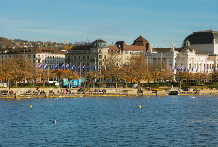 Zurich, Switzerland - October 25, 2017: people on the embankment of Lake Zurich in the city of Zurich. Zurich is the largest city in Switzerland and the capital of the Swiss canton of Zurich, Lake Zurich is a lake extending southeast from it.