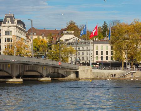 Zurich, Switzerland - October 25, 2017: partial view of the Quaibrucke bridge and embankment of Lake Zurich in the city of Zurich. Zurich is the largest city in Switzerland and the capital of the Swiss canton of Zurich, Lake Zurich is a lake extending sou