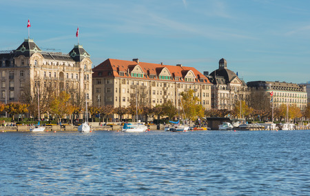 Zurich, Switzerland - October 25, 2017: buildings of the city of Zurich along Lake Zurich at sunset. Zurich is the largest city in Switzerland and the capital of the Swiss canton of Zurich, Lake Zurich is a lake extending southeast from it.