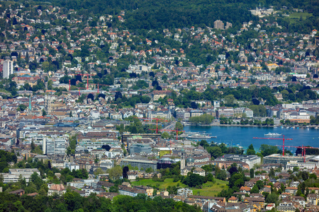 Zurich, Switzerland - June 5, 2019: the city of Zurich as seen from Mt. Uetliberg. The Uetliberg is a mountain rising to 870 m and offering a panoramic view of the entire city of Zurich, which is the largest city in Switzerland and the capital of the Swis Sajtókép