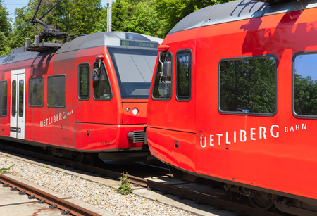Zurich, Switzerland - June 5, 2019: two locomotives of a train of the Uetliberg railway line standing at the station on the top of Mt. Uetliberg, main focus on the closer one. The Uetliberg railway line (German: Uetlibergbahn) connects the Zurich main rai Sajtókép