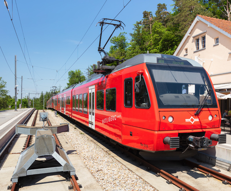 Zurich, Switzerland - June 5, 2019: a train of the Uetliberg railway line at the station on the top of Mt. Uetliberg. The Uetliberg railway line (German: Uetlibergbahn) is a passenger railway line connecting the Zurich main railway station (German: Zurich