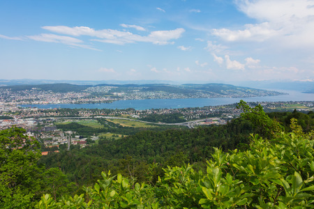 View from from Mt. Uetliberg in Switzerland in summer. The Uetliberg is a mountain rising to 870 m and offering a panoramic view of the entire city of Zurich and Lake Zurich. Stock fotó