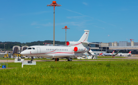 Kloten, Switzerland - June 8, 2019: airplanes at Zurich Airport,  a Dassault Falcon 7X in the foreground. The Dassault Falcon 7X is a large-cabin business jet manufactured by the Dassault Aviation company, Zurich Airport is the largest airport in Switzerl Sajtókép
