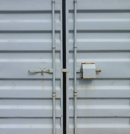 Partial view of the doors of an old cargo container.
