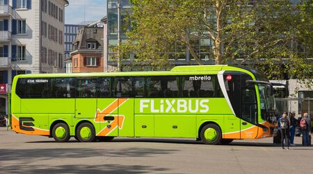 Zurich, Switzerland - May 27, 2019: a Flixbus bus at a bus station in the city of Zurich, people at it. The Flixbus is a German brand offering intercity coach services in various European countries and in the USA. Sajtókép