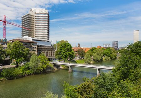 Zurich, Switzerland - May 27, 2019: buildings of the city of Zurich along the Limmat river. Zurich is the largest city in Switzerland and the capital of the Swiss canton of Zurich. Sajtókép