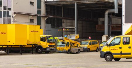 Zurich, Switzerland - May 27, 2019: parked vehicles of the Welti-Furrer company. The Welti-Furrer is a leading expert for residential or business move, storage and warehouse logistics. Sajtókép
