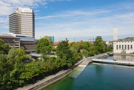 Zurich, Switzerland - May 27, 2019: view along the Limmat river in the city of Zurich. Zurich is the largest city in Switzerland and the capital of the Swiss canton of Zurich.
