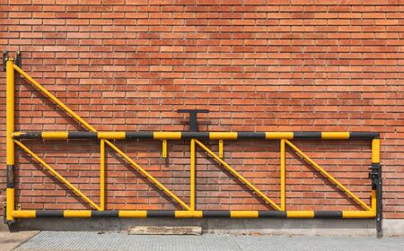 A brick wall of a building gate Stock Photo