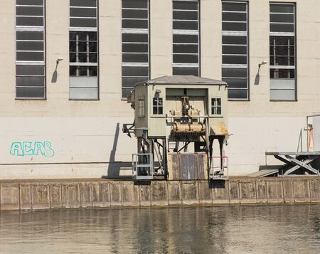 Zurich, Switzerland - May 27, 2019: partial view of the building of the Kraftwerk Letten hydroelectric power plant on the Limmat river in the city of Zurich. Kraftwerk Letten generates electric power since 1893, it is owned and operated by the EWZ company Editorial