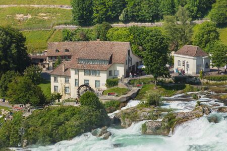 Neuhausen am Rheinfall, Switzerland - June 7, 2019: the Rhine Falls waterfall. The Rhine Falls waterfall (German: Rheinfall) is located on the Rhine river, on the border between the Swiss cantons of Schaffhausen and Zurich, it is a popular tourist destina