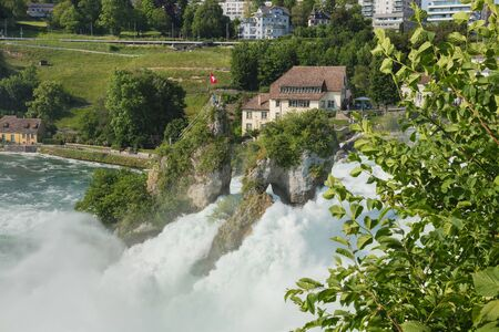 Laufen, Switzerland - June 7, 2019: the Rhine Falls waterfall as seen from the Laufen Castle. The Rhine Falls waterfall (German: Rheinfall) is located on the Rhine river, on the border between the Swiss cantons of Schaffhausen and Zurich, it is a popular  Editorial