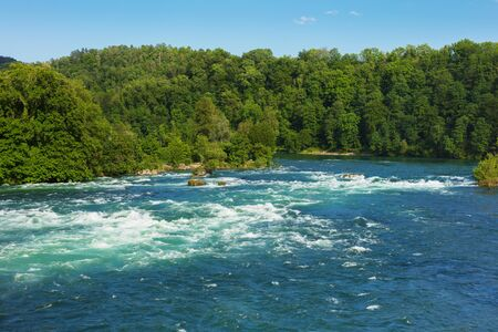 The Rhine river just above the Rhine Falls waterfall in Switzerland at the beginning of June. Stock Photo