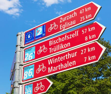 Laufen-Uhwiesen, Switzerland - June 7, 2019: a directional sign showing directions and distances to some of the closest localities. Laufen-Uhwiesen is a municipality in the district of Andelfingen in the Swiss canton of Zurich. Editorial