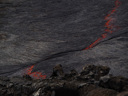 continuously: Lava burst inside the Erta Ale volcano. This lava lake is continuously flowing and bubbling inside this 60m-large crater. Located in Ethiopia, close to the border with Erithrea.