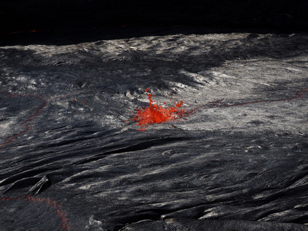 continuously: Lava burst inside the Erta Ale volcano. This lava lake is continuously flowing and bubbling inside this 60m-large crater. Located in Ethiopia, clear to the border with Erithrea.
