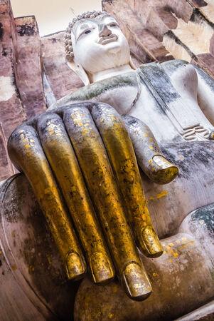 chum: Golden fingers of Buddha Statue in Wat Sri Chum Temple, Sukhothai Historical Park, Thailand