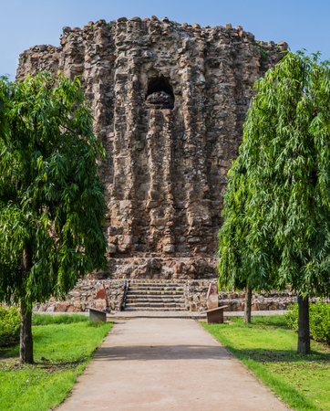 archeological: Alai Minar, the unfinished brick minaret of Qutb complex, Mehrauli archeological park, Delhi, India