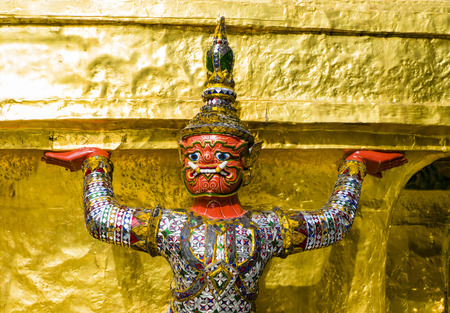 the grand palace: Close-up of a demon guardian supporting Wat Phra Kaew (buddhist temple), Grand Palace, Bangkok, Thailand Editorial