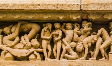 naked statue: Stone carved erotic sculpture in Khajuraho temple, India