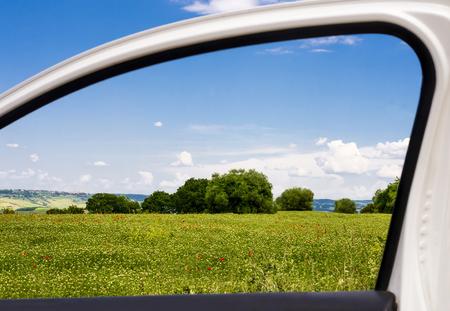 Countryside viewed through a car window