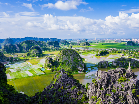 Panoramic view of karst formations and rice paddy fields in Tam Coc, Ninh Binh province, Vietnam Stock Photo