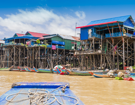 Colorful boats and stilt houses in Kampong Phluk floating village, Tonle Sap lake, Siem Reap Province, Cambodia Stock Photo