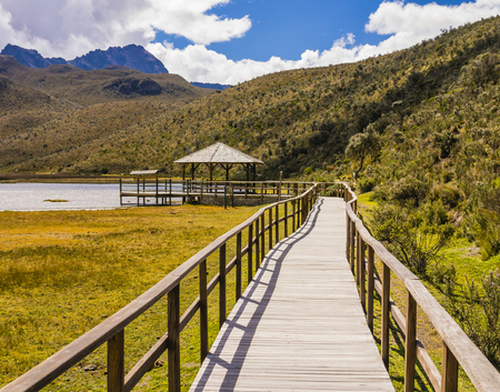 Wooden walkway crossing Limpiopungo Lagoon, Cotopaxi National Park, Ecuador Stock Photo