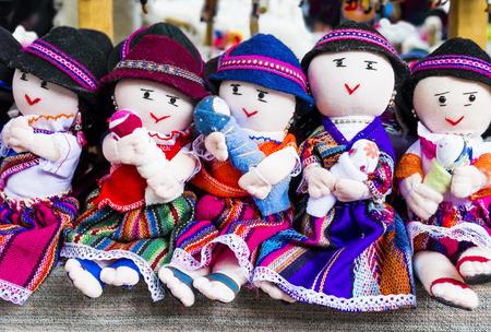 Row of rag dolls in traditional clothes, Otavalo Market, Ecuador