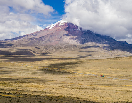 Panoramic view of snow capped Chimborazo volcano, the farthest point from Earths center, Cordillera Occidental of the Andes, Ecuador