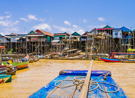 Picturesque Kampong Phluk floating village with multicolored boats and stilt houses, Tonle Sap lake, Siem Reap Province, Cambodia