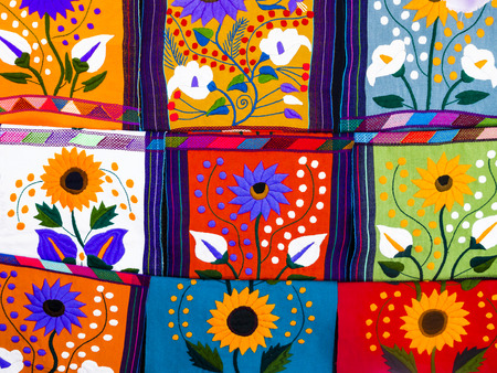 Multicolored ethnic placemats with floral patterns and geometric shapes