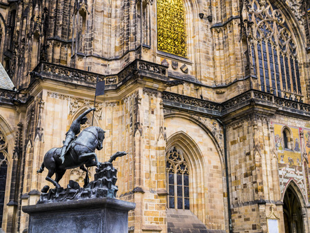 Equestrian statue of Saint George with St. Vitus cathedral in background, Prague castle, Czech Republic