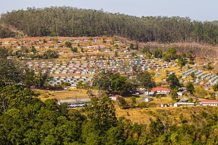 Panoramic view of typical village with colorful houses arranged in geometric manner, Swaziland, South Africa