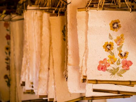 Showcase of Antemoro paper sheets, a flower embedded paper traditionally used to record secret knowledge, Ambalavao, Madagascar